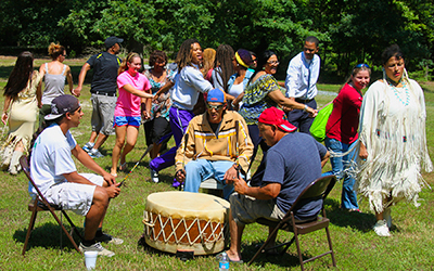"RCC students perform ""Snake Dance"" with members of Rappahannock Tribe."