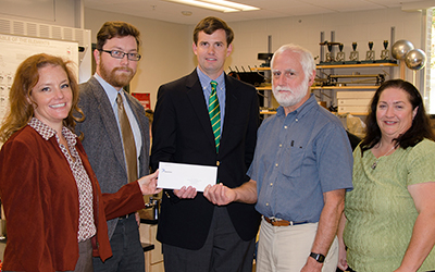 RCC's science faculty happily accept a $35,000 check from James Beasley, external affairs manager of Dominion Virginia Resources.
