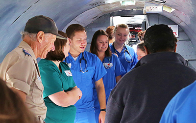 RCC faculty and students about the history of the plane and of the organization.