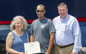 "Stuart ""Mack"" MacCreary, an employee of Deltaville Yachting Center, accepts his Virginia journeyman certificate as an advanced marine services technician"