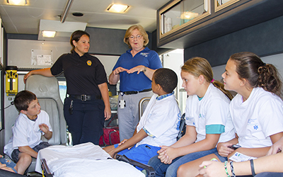 Middle school students attending a Summer Health Academy at RCC's Kilmarnock Center were allowed to experiment with the equipment in the college's mobile simulation ambulance.