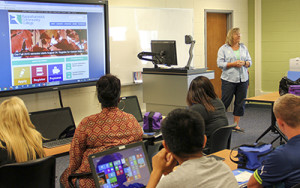 Kristy Walker of RCC's technology department gives new students a technology overview.