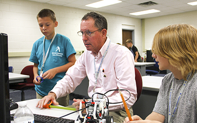 Engineering instructor Pat Roane demonstrates principles of computer design at the Summer STEM Academy for middle schoolers recently held at RCC's Glenns Campus.