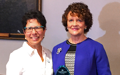 RCC's Dr. Virginia Jones (right) was named a Fellow of Darden College of Education at Old Dominion University by the dean of Darden College, Dr. Jane Bray.