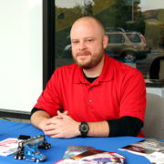 Dustin Campbell of CDS Tractor-Trailer Training awaits interviewees at RCC's recent Career Fair.