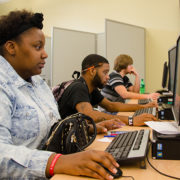 On National Financial Aid Day, October 19, over 80 RCC students attended a four-hour event organized by the college's Financial Aid Office. Shown filling out online application forms for federal financial assistance are (left to right): Quinshon Carter of Westmoreland County, Quanté Ball of Richmond County, and Alston Hayes of Essex County.