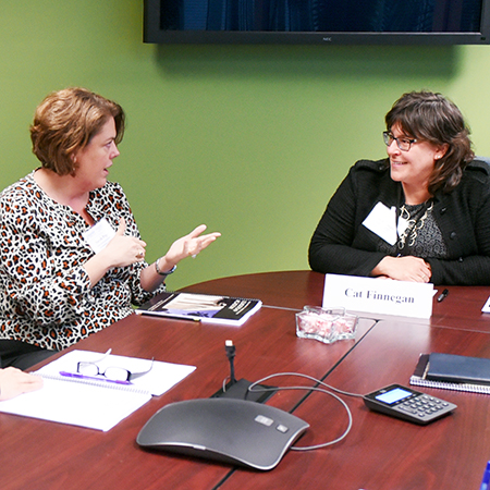 In a breakout group at the VCCS Faculty and Administrators' Leadership Academy 2016, RCC's dean of college advancement, Sarah Pope, discusses the challenges and opportunities of a leadership role with the group's mentor, Cat Finnegan (VCCS assistant vice chancellor for institutional effectiveness).