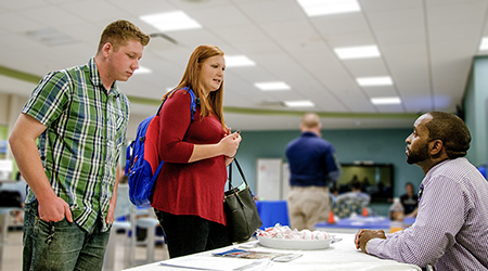 Noah Woolard and Carlee Browder, both of Middlesex County, speak with Bryant Hudgins, administrator of the Virginia Health Services Lancashire Convalescent and Rehabilitation Center.