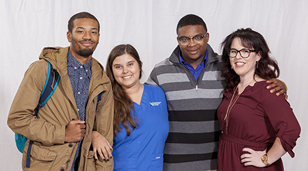 Multiple scholarship opportunities give RCC students something to smile about. Left to right: Davon Hamilton, Westmoreland County; Canvas Foxwell, Essex County; Dominique Liles, Westmoreland County; and assistant professor Kelly Cutchin of RCC's English faculty.