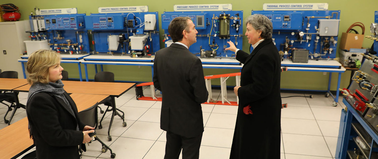 Dr. Crowther shows off the newly redesigned Industrial Manufacturing and Engineering Lab at the Glenns Campus, during Governor Northam's tour of campus.