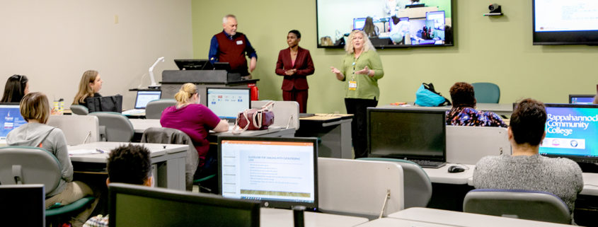 From left: Dr. Charles Smith, Dean of Health Sciences (RCC), Dr. Jeannetta Hollins, Assistant Dean of Student Success (VCU), Dr. Tammy E. Williams, Coordinator, RN to BS Program (VCU) speak before a crowd of students at RCC's Warsaw and Glenns campuses via interactive video